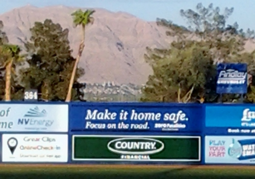 "At Cashman field, a public service ad on the outfield wall says, ""Make it home safe. Focus on the road."" Visible in the distance is the Las Vegas Nevada temple.  Your spiritual thought for the day."